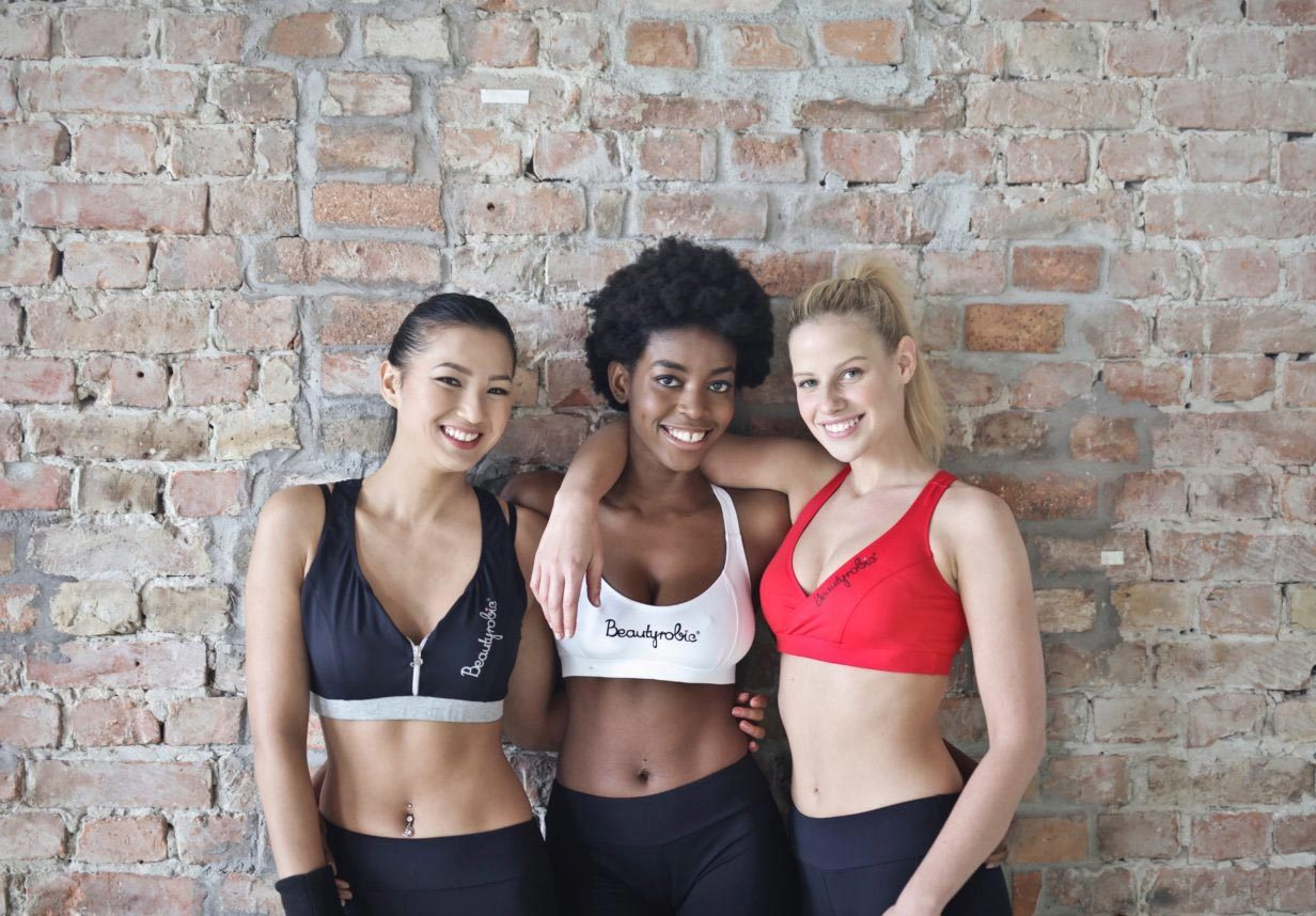 exercise girls leaning on wall